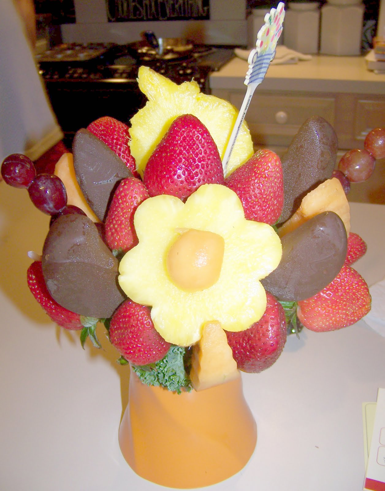 deanna s corner  oh goodness it was so delicious those are chocolate covered apples they were sour apples covered a dark chocolate amazing the pineapple was freshly