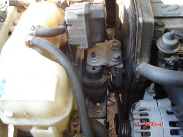 reservoir and upper motor mount water pump and coolant manifold