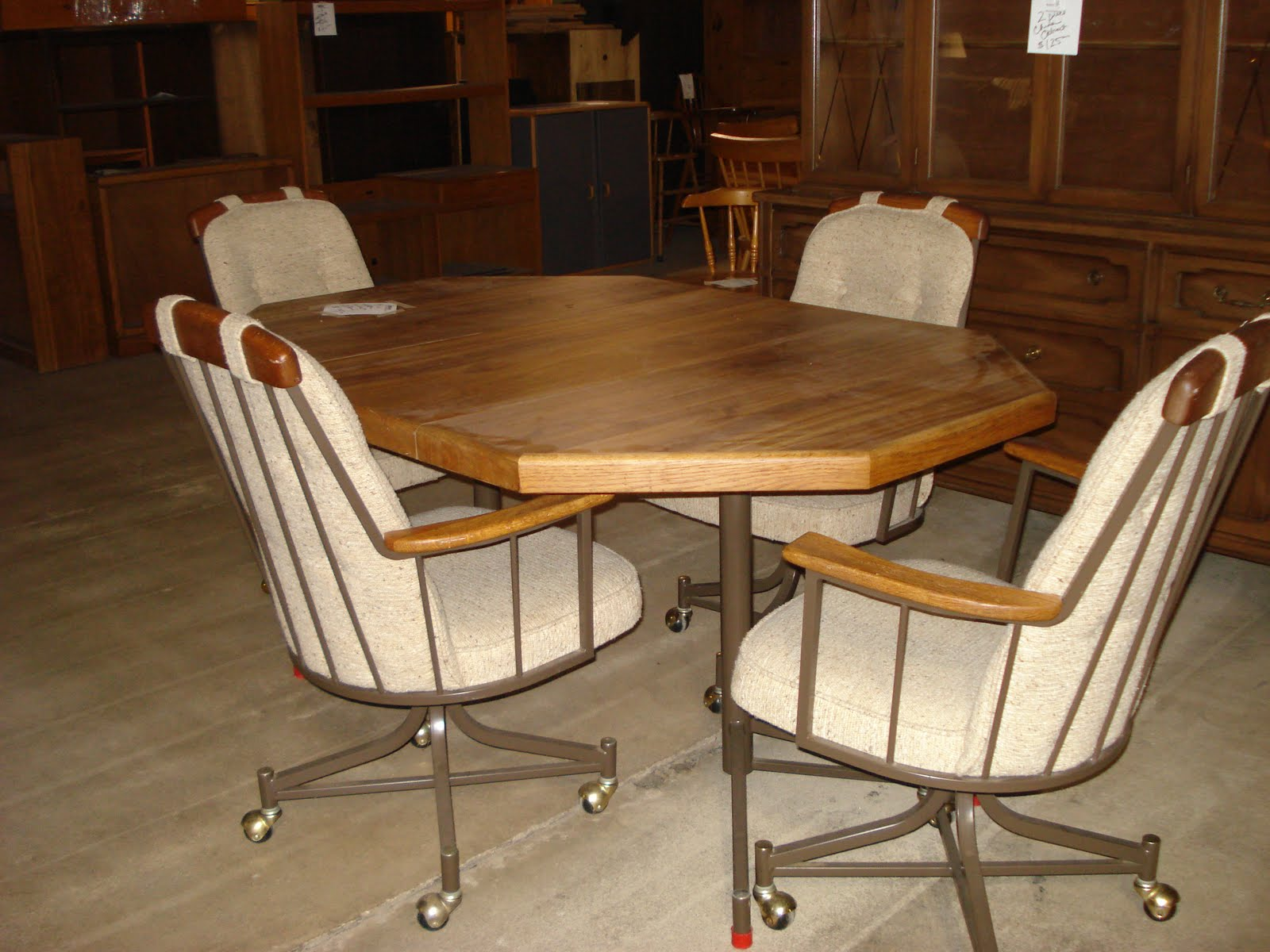 Glass Top Kitchen Table With Wheeled Padded Chairs