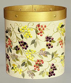 round wastebasket with grapevine motif