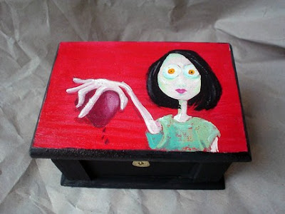 box with picture of woman holding a heart in her hand
