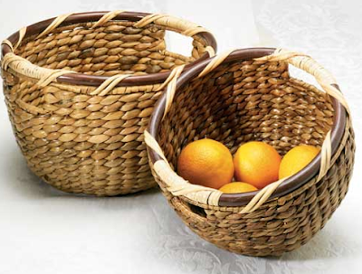 2 round water hyacinth baskets; one has fruit inside
