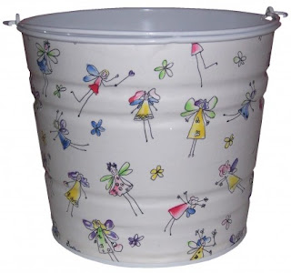 white pail with pictures of fairies