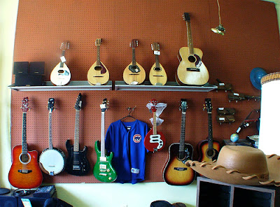 pegboard holding guitars
