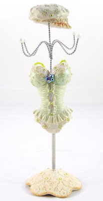 jewelry mannequin in green corset