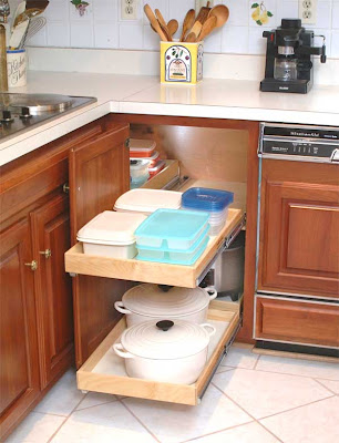 pull-out shelves holding pots and food stroage containers
