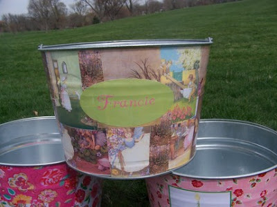 bucket with fairies, perched on 2 other buckets