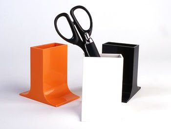 melamine pencil cups in three color choices: orange, black, and white