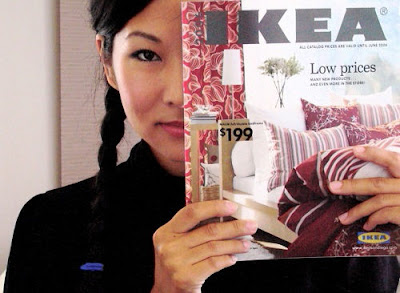 woman holding Ikea catalog