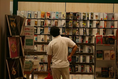 person in bookstore, deciding what book to get
