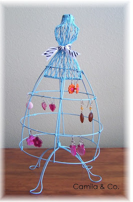blue wire dress holding jewelry