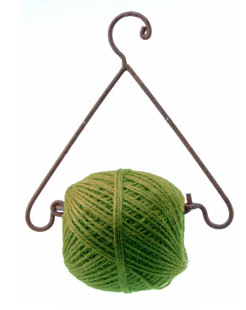 green twine on hanging dispenser