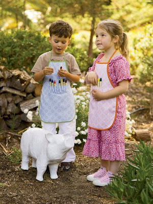 children wearing art aprons