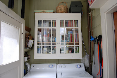 laundry area with cabinet, doors shut