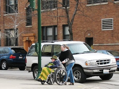caregiving - helping elder in a wheelchair