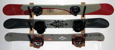 wall-mounted rack for three snowboards