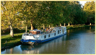 Cruise the canal du midi in the south of France aboard the French hotel barge Clair de Lune - Contact ParadiseConnections.com for more details