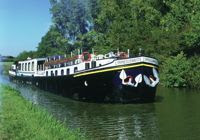 Cruise the European Canals on a Crewed Hotel Barge - ParadiseConnections.com