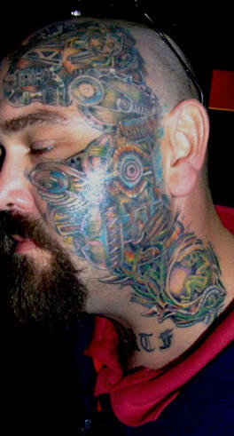 40bb9109009be ThePanday: Biomech Face and Neck Tattoo Design
