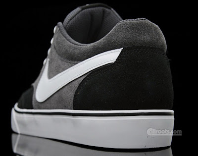 """722d59ad48e893 This colorway is predominantly suede black and """"Raiders Grey"""" upper. White  accents on the shoe laces"""