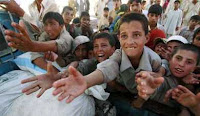Internally Displaced Persons from Swat Valley Pakistan  reaching out for food. Source: Reuters