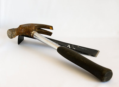 a larger metal-shanked hammer and a small multi-purpose prybar, copyright J.Gracey Stinson
