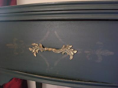 distressed stencil on black cabinet
