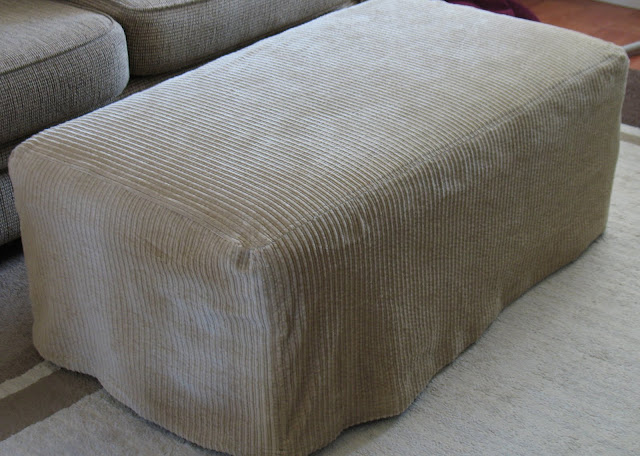 Admire your new ottoman slipcover! - Ottoman Slipcover Tutorial. - Sew Much Ado