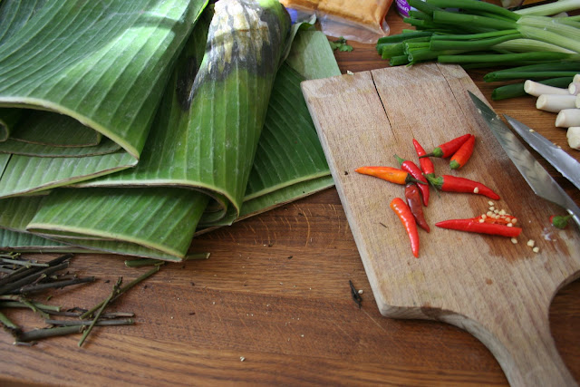 A banana leaf and chopping chillies