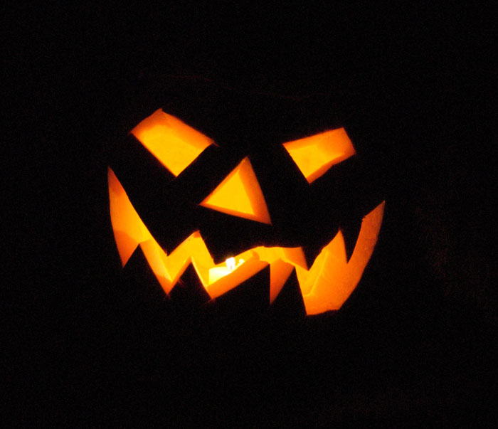 This Jack-O-Lantern is on our front porch. We had fun carving him out, and went for a classic pumpkin face!