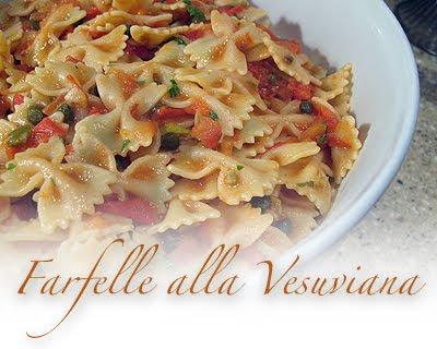 A close up photo of farfelle alla vesuvinana in a bowl.