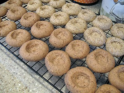 A photo of chocolate Nutella thumbprint cookies resting on a cooling rack.