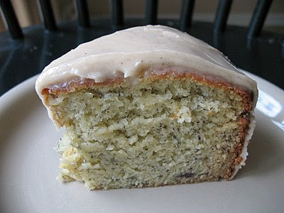 A close up photo of a slice of bananas and cream Bundt cake with brown butter glaze.