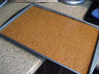 A photo of a pan of carrot cake tower batter.