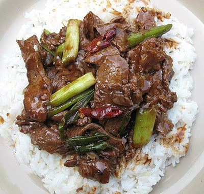 An overhead photo of stir fried spicy beef over rice.