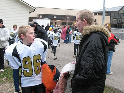 An old photo of Amanda\'s son TJ talking to his big brother, Tony.