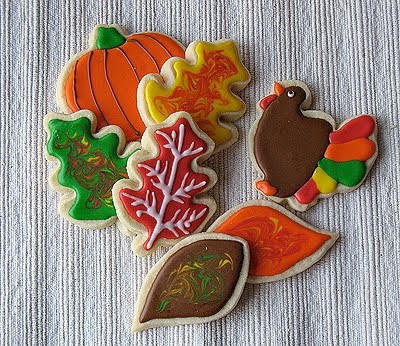 A photo of an assortment of thanksgiving cookies.