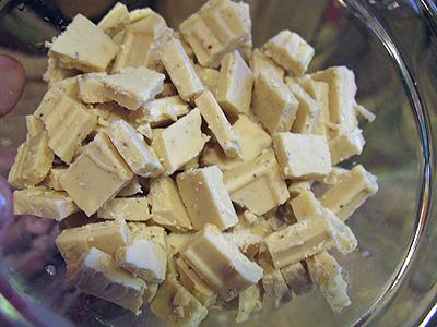 A close up photo of chopped white chocolate.