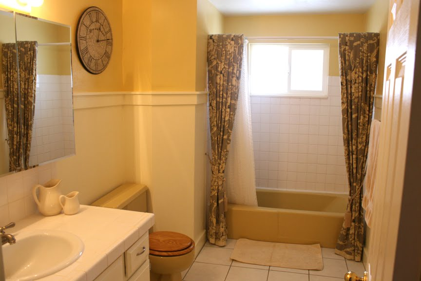 Mustard yellow tub and toilet updated bathroom for Yellow and brown bathroom decor