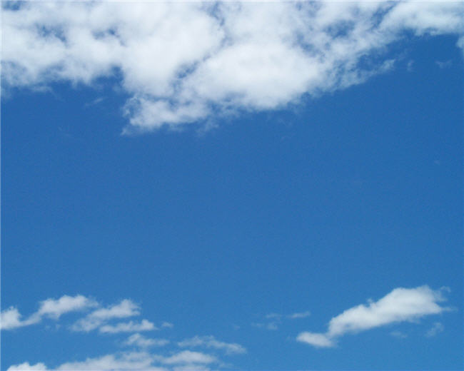 blue sky and fluffy clouds
