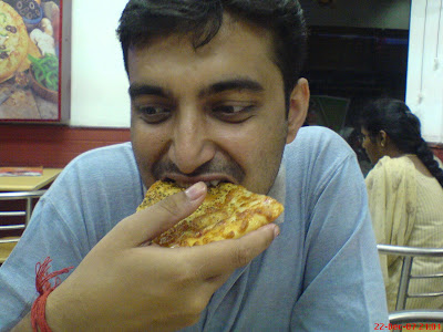Sayak Roy Choudury eating pizza