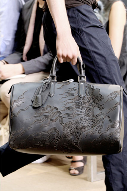tattooed leather bags