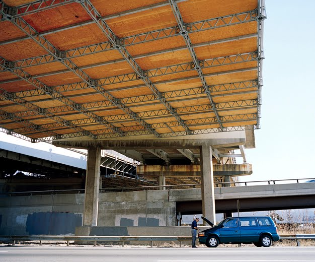 Man Under Overpass, New Jersey Turnpike, New Jersey by Amy Stein